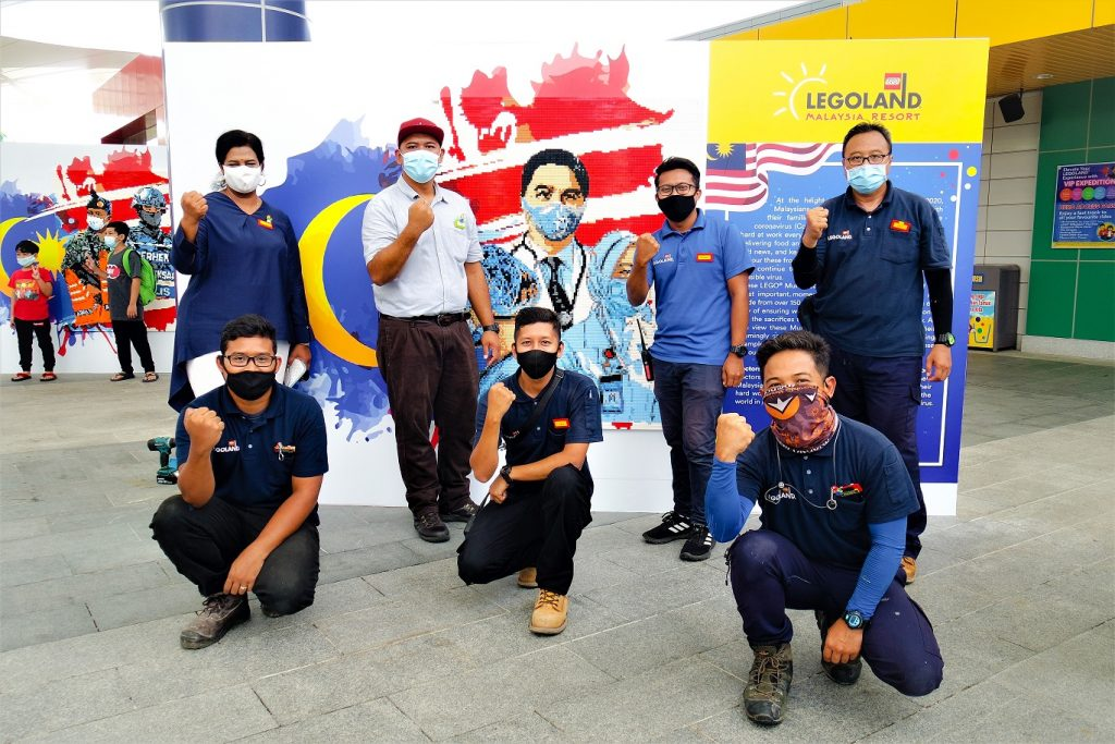 Thila Munusamy, Director of Sales and Marketing LEGOLAND Malaysia Resort with part of the team that has helped create the Lego Frontliner Tribute Murals