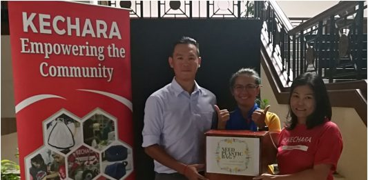 (From left) General Manager, Tan Kai Yang and Senior Operations Manager, Jamie Lau of Ponderosa presenting cash to Merlin Hoo, Branch Manager of Johor's Kechara Soup Kitchen Society